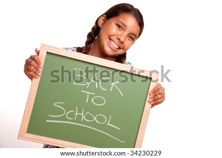 Pretty Hispanic Girl Holding Chalkboard with Back To School Isolated on a White Background.