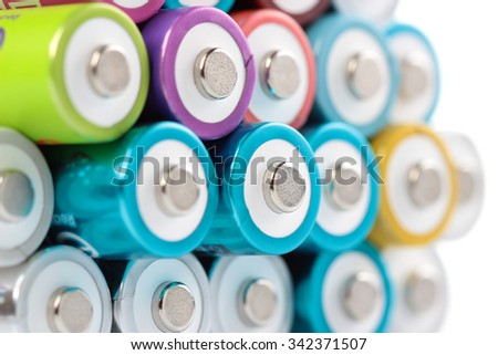 Several AA batteries in perspective closeup view on white background #342371507