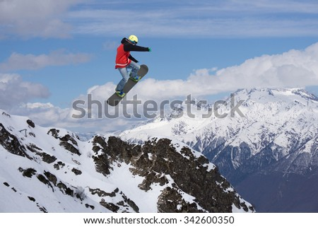 Flying snowboarder on mountains. Extreme winter sport #342600350