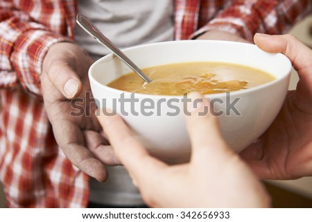 Homeless Man Being Handed Bowl Of Soup By Volunteer #342656933