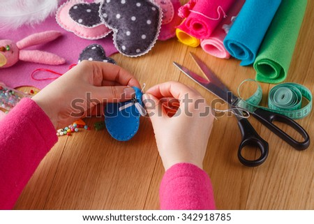 Needlework concept. Female doing crafts from felt #342918785