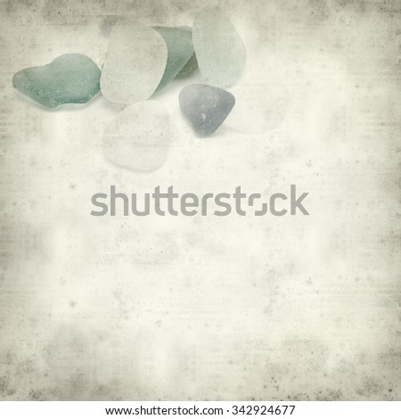 textured old paper background with sea glass pieces #342924677