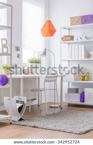 Photo of decorative orange lamp in new room #342952724