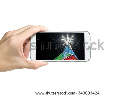 Holding smart phone for capture, Take a photo of Christmas Tree of Siam paragon , Thailand.