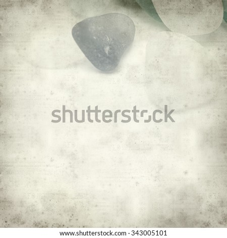 textured old paper background with sea glass pieces #343005101