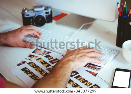 Man using his computer at his desk in his office