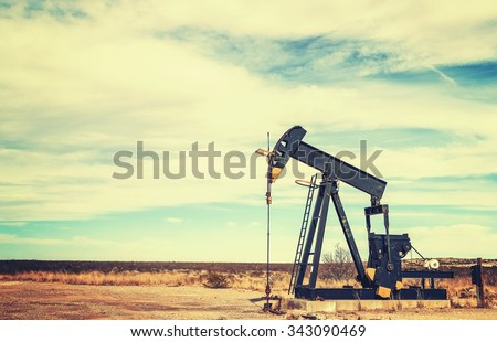 Vintage toned picture of an oil pump jack, Texas, USA.