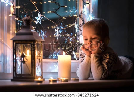 Child at Christmas eve and New Year #343271624