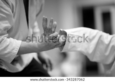 Pain control in martial arts Royalty-Free Stock Photo #343287062