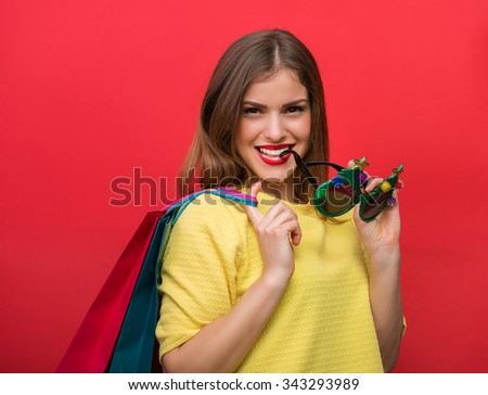 Woman with Christmas party glasses and shopping bags #343293989