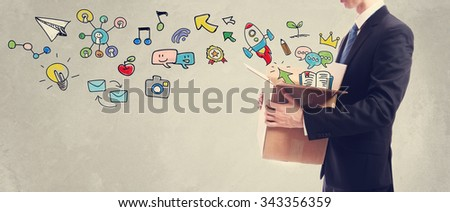 Creativity concept with businessman holding a cardboard box #343356359