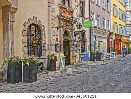 GRAZ, AUSTRIA - JANUARY 7, 2014: Street view to Landhaus Keller Restaurant in Schmiedgasse in the Old City of Graz in Austria in January #343501211