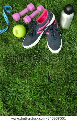sports equipment on green grass background #343639001
