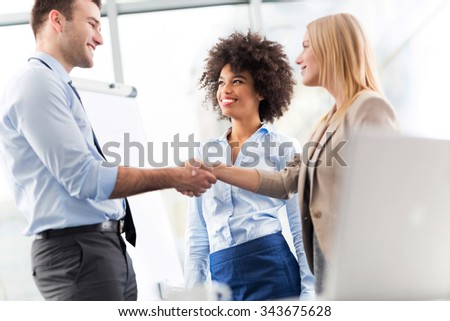 Businesspeople shaking hands #343675628