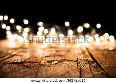 Blur christmas lights on wooden planks, low depth of focus with copyspace