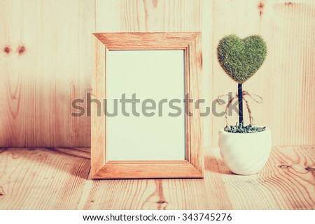 Blurred Picture frames on the wooden floor #343745276