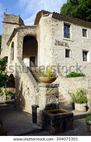 SAINT-GUILHEM-LE-DESERT, FRANCE â?? CIRCA JULY 2015 Mairie and spring water                                #344071301