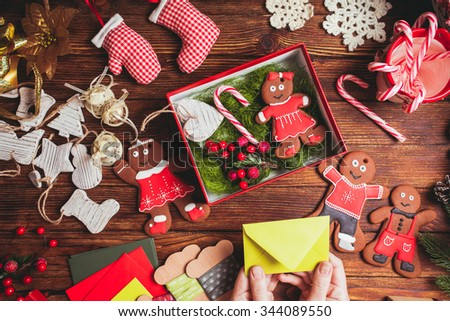 Preparation a Christmas gift box for friends #344089550