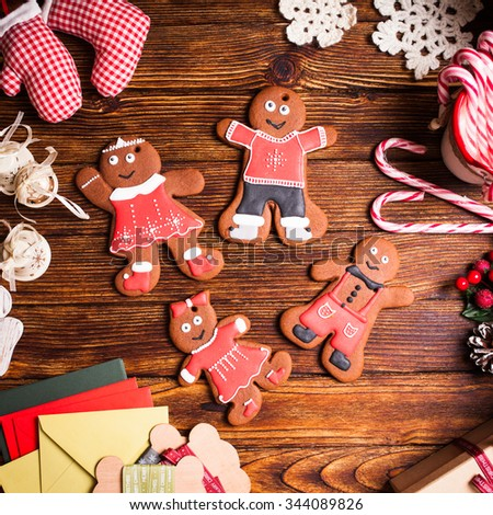 Christmas gingermen family on a wooden table #344089826