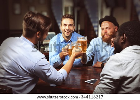 Young men drinking beer and talking in cafe #344116217