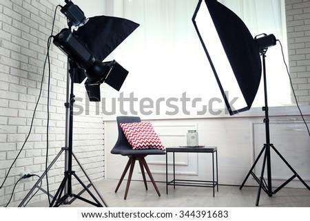 Photo studio with modern interior and lighting equipment #344391683