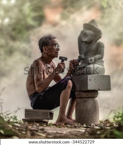 Stone carver, Thailand #344522729