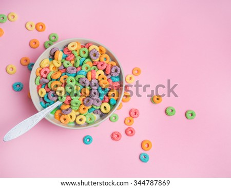 Colorful cereal in white bowl with shoon on a white background #344787869