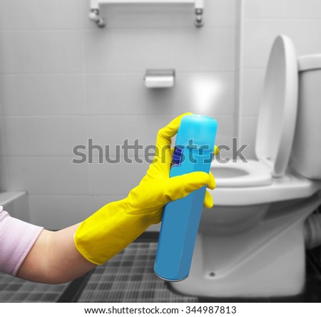 air freshner in hand in toilet #344987813