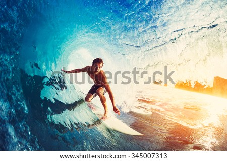 Surfer on Blue Ocean Wave Getting Barreled at Sunrise Royalty-Free Stock Photo #345007313
