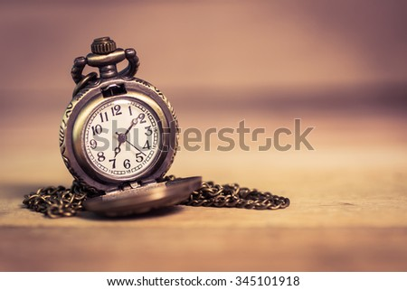 "pocket watch ,selective focus . Focus area are the dial of the clock,picture style ""old image"""