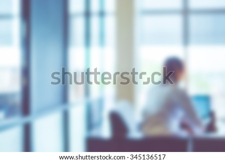 Blurred background : officer working on computer at office building,Business background with vintage filter
