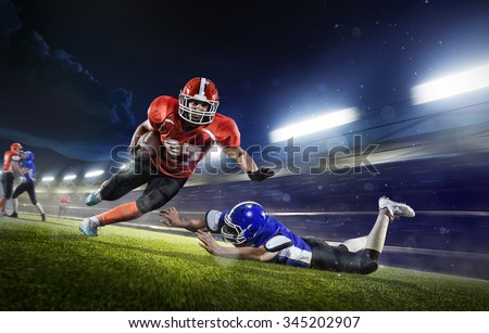 american football players in the action grand arena Royalty-Free Stock Photo #345202907