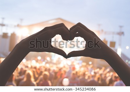 She loves this band! Heart shape for the music. Royalty-Free Stock Photo #345234086