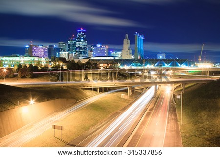 A long exposure of an elevated view of Kansas City, Missouri skyline at night.