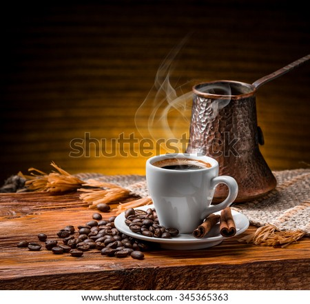 Coffee cup and saucer on a wooden table #345365363