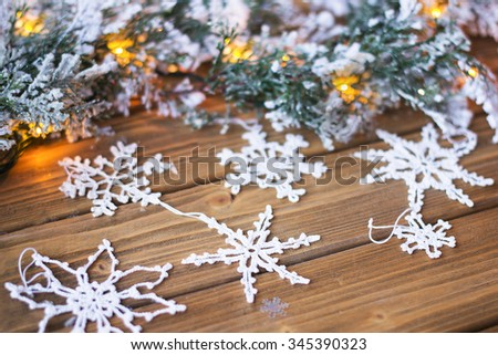 Handmade crochet snowflakes on the wooden background. Low depth of focus image