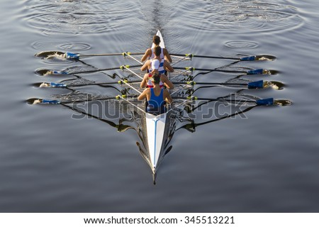 rowers paddling in a beautiful italian lake Royalty-Free Stock Photo #345513221