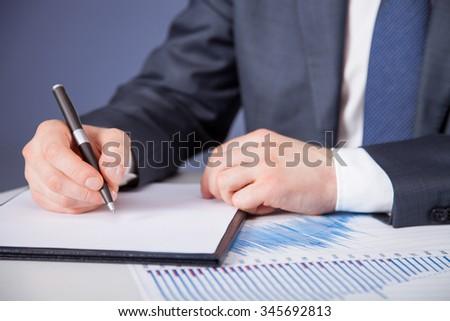 Businessman signing a document - closeup shot #345692813