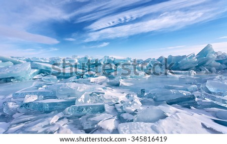 Field of ice hummocks on the frozen Lake Baikal Royalty-Free Stock Photo #345816419