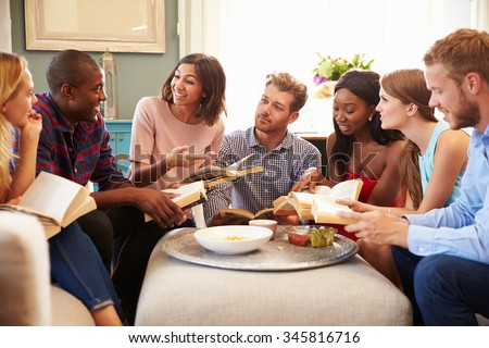 Group Of Friends Taking Part In Book Club At Home Royalty-Free Stock Photo #345816716