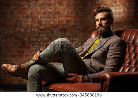 bearded man with a very interesting look Royalty-Free Stock Photo #345880196