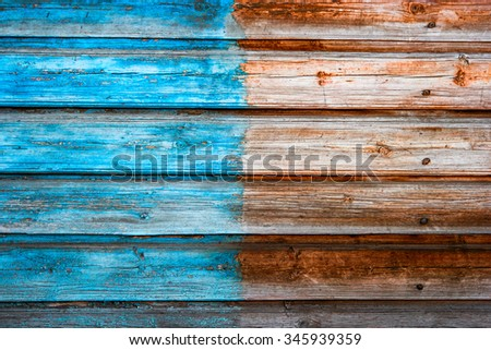 Weathered plank background half painted in blue color, a lot of copy space #345939359