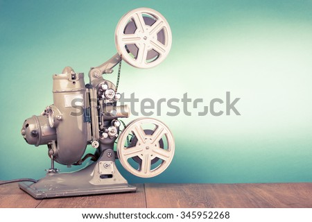Retro old reel movie projector for cinema. Vintage style filtered photo