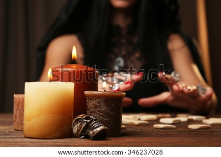 Witch - fortune teller reading fortune close up #346237028