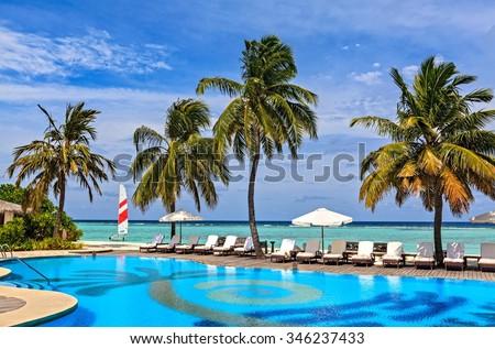 Beach pool in a tropical hotel Palm Beach. Maldives, The Indian Ocean #346237433