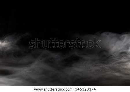 Abstract  fog or smoke move on black color background Royalty-Free Stock Photo #346323374