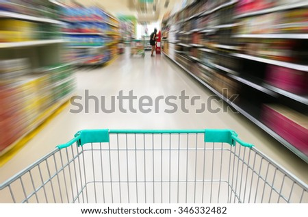 shopping at supermarket with trolley #346332482