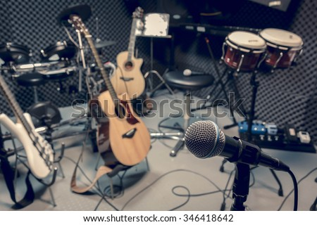 selective focus microphone and blur musical equipment guitar ,bass, drum piano background. Royalty-Free Stock Photo #346418642