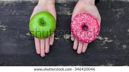 Choosing between apple and donut #346420046