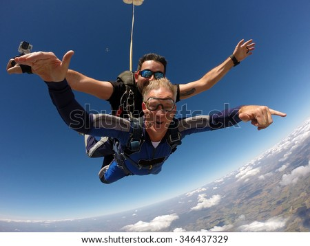 Skydiving tandem happiness middle aged man #346437329